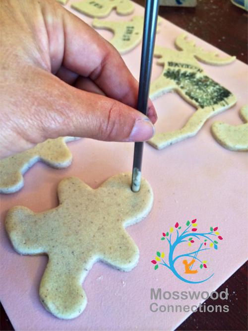 Poking Holes for the Salt Dough Ornaments