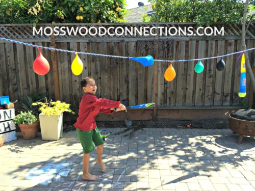 Pendulum Water Blast: a Visual Tracking Activity #mosswoodconnections #visiongames #visualtracking #grossmotor #sensory